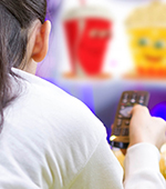 Young person viewing food adverts on TV