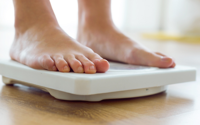 Feet on a weighing scale