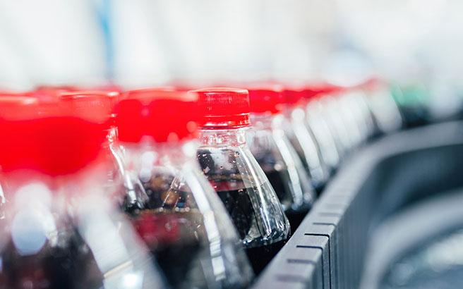 Drink bottles on a factory conveyor belt