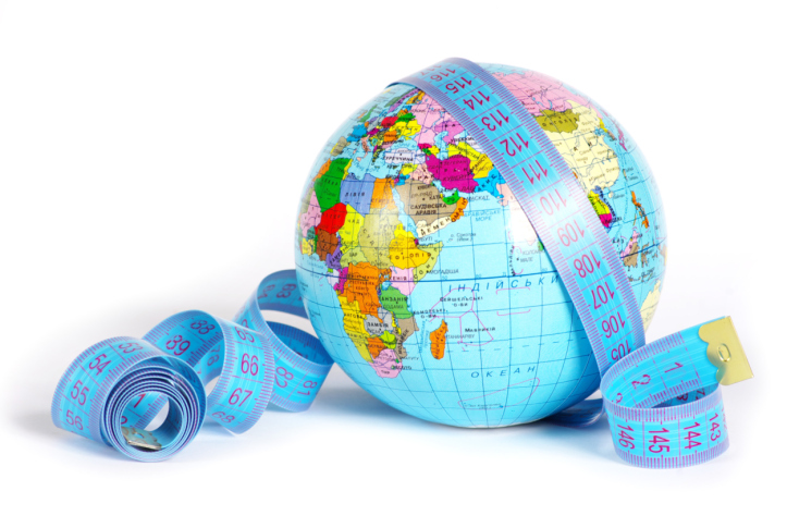 Globe draped with measuring tape