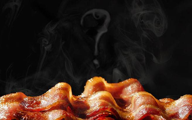Bacon with steam shaped like a question mark