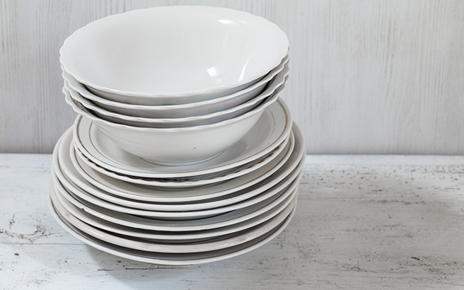 A pile of plates and dishes