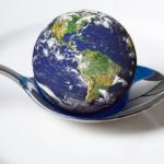A globe sitting in a dessertspoon