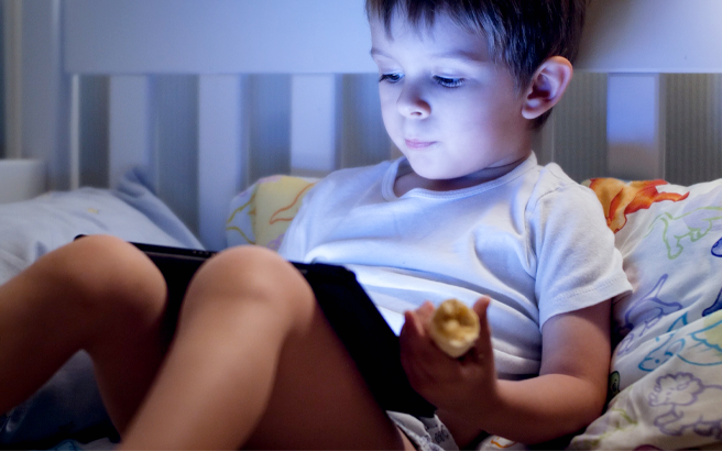 A young child using a tablet